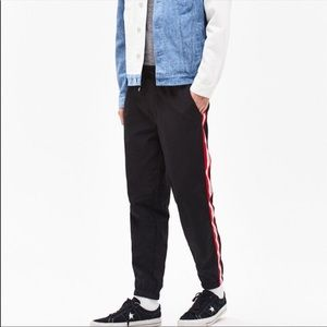 PacSun sweatpants with red and white side stripes